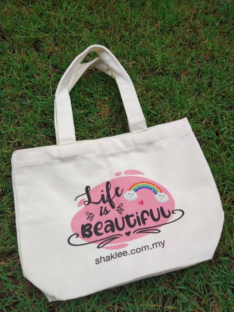 Life is beautiful tote bag back | Azura Abdul